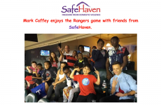Mark Caffey enjoys the Rangers Game with friends from SafeHaven